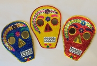 Image Tin Calavera with Reflecting Eyes
